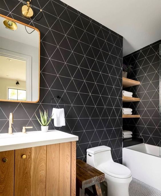 a stylish bathroom with catchy black geometric walls, white appliances and light stained wooden items is amazing