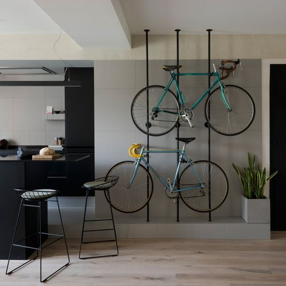 metal slabs are great to hold your bikes and they look stylish and cool and integrate them into the interior in a lovely way
