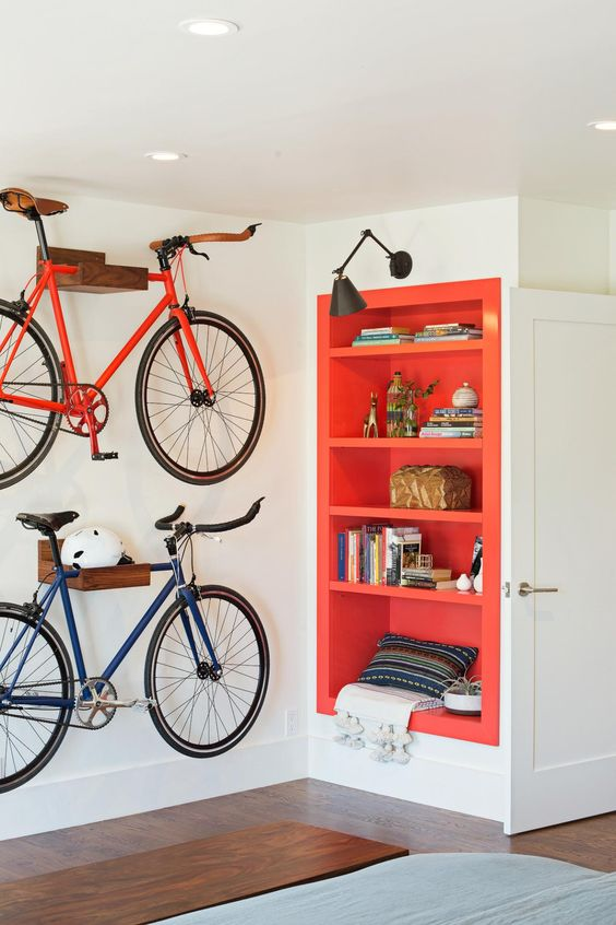 plywood holders for bikes will make them part of decor and will add a cool feel to the interior, besides, you won't waste any floor space