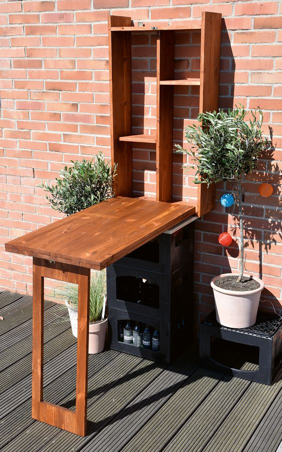 a Murphy table for outdoors can be used as a bar or or storing, decorate it with potted greenery