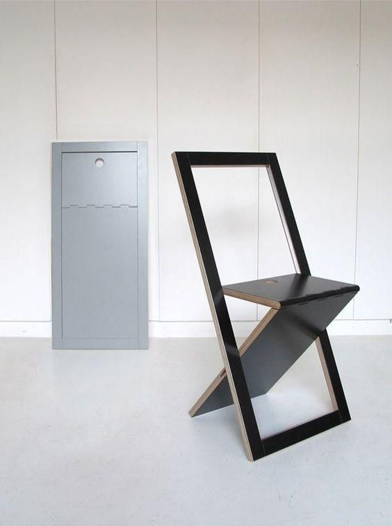 a black minimalist folding chair is a cool idea for any small modern space