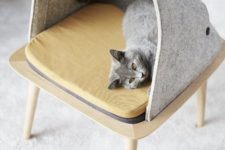 a cozy cat bed designed as a stool with a felt hood and a cushion is a very stylish piece for a cat to sleep in