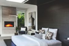 a dark stained platform continued up to the headboard and further to create a cozy curled up look
