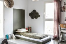 a grey platfrom raises the sleeping space and gives much storage space with drawers without clutter