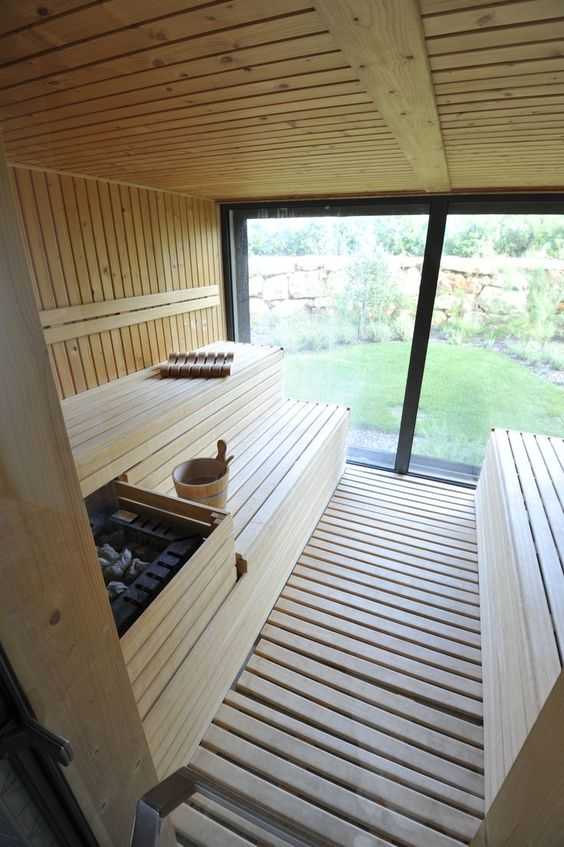 a home sauna with a glass wall, clad with wood is very welcoming and very inviting