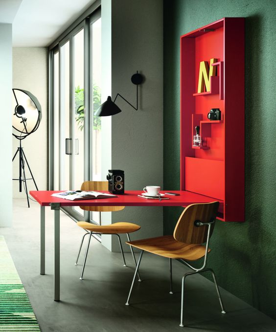a hot red folding desk or dining space with some shelves inside is a cool option for a small space