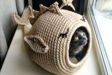 a knit fish cat bed and house is a funny and cool idea that will bring a touch of whimsy