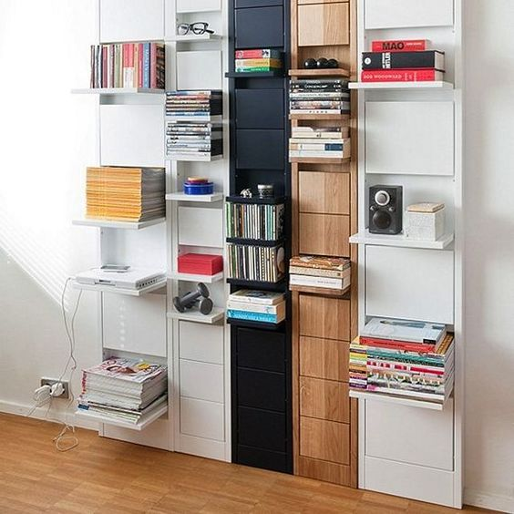a large wall-mounted storage unit with various foldable shelves that can be hidden anytime