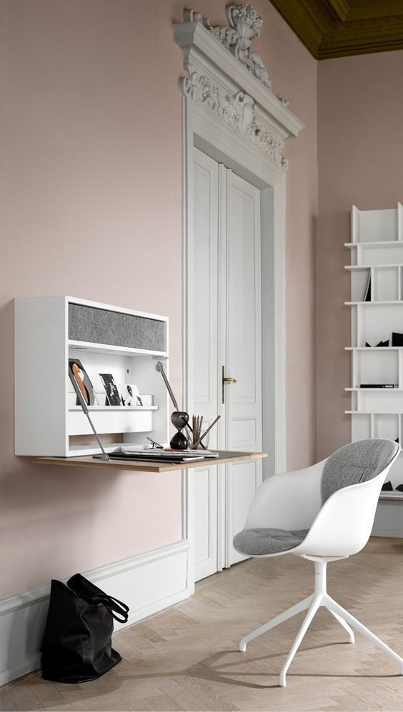 a minimalist storage unit with a foldable desk and a drawer inside will fit any minimalist space