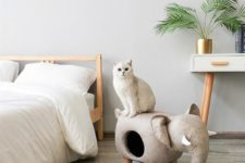 a neutral elephant cat bed that doubles as an ottoman is a cool and chic idea for a modern space
