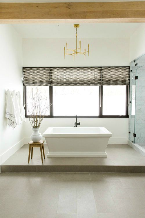 a platform makes the bathtub a focal point and creates a chic oasis for bathing and relaxing