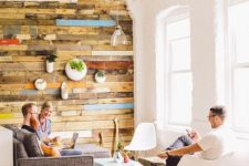a platform of pallet wood is a stylish way to separate the living room from the rest of the layout
