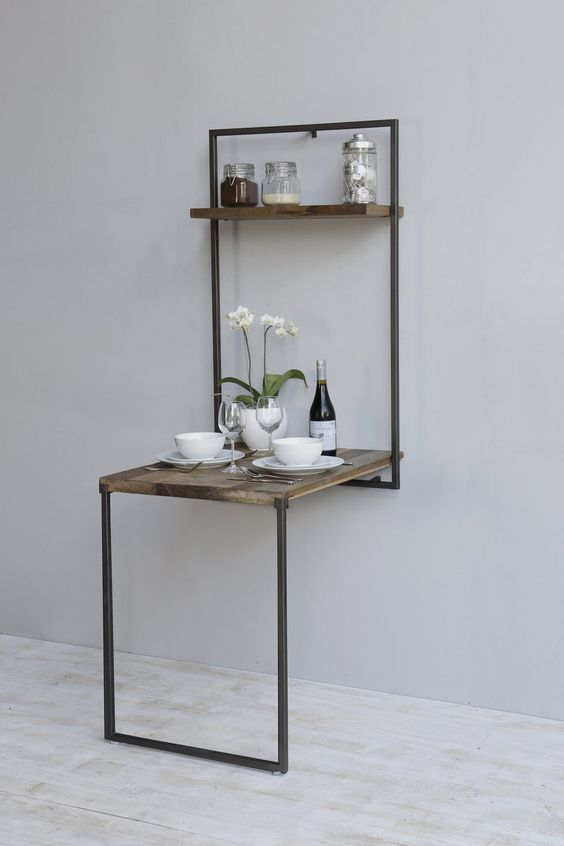 a rustic folding table like this one can be used for dining to as a breakfast nook and hidden anytime