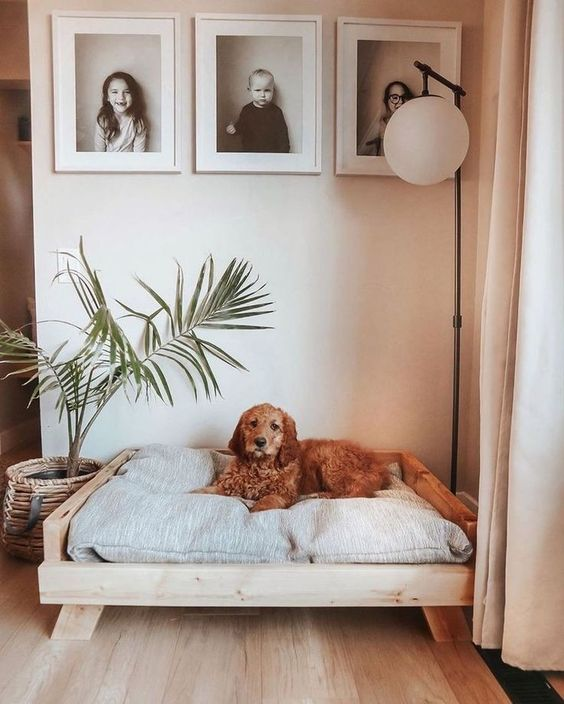 a simple and cool wooden bed with a grey mattress is a lovely idea for many interiors and it can be easily DIYed