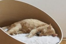 a sleek and stylish asymmetrical cat bed with faux fur is a chic idea for a contemporary or minimalist space