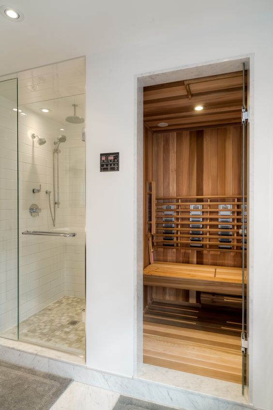 a small home steam room done with wood, with built in lights is cool and cozy