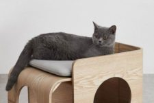 a stylish modern cat bed and house in one with holes is a very cool piece for your pet