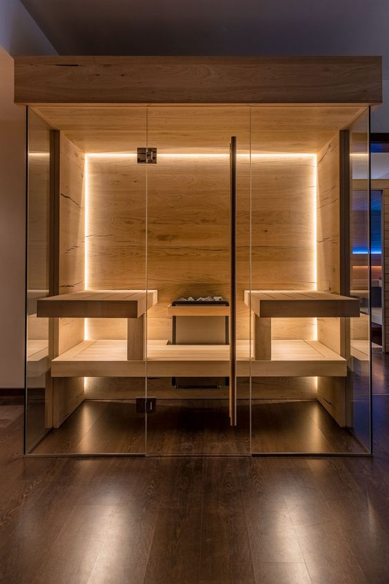a stylish modern wood clad sauna with built-in lights and benches is very inviting and cool