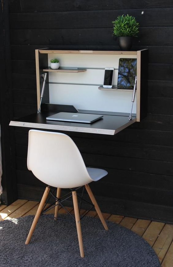 a stylish wall mounted foldable desk in neutrals and dark colors is a very stylish idea suitable for small spaces