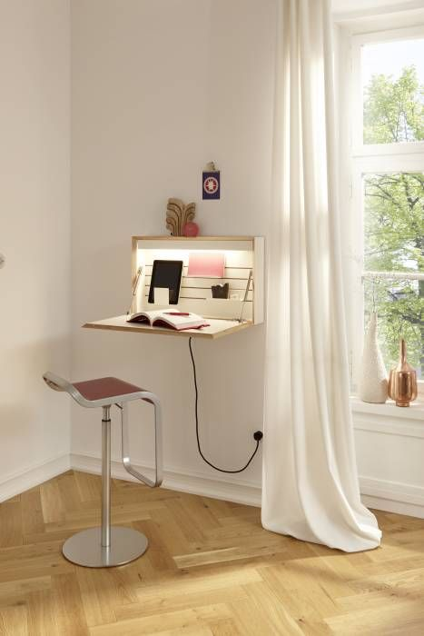 a wall mounted foldable mini desk with built in lights and with books and other necessary stuff