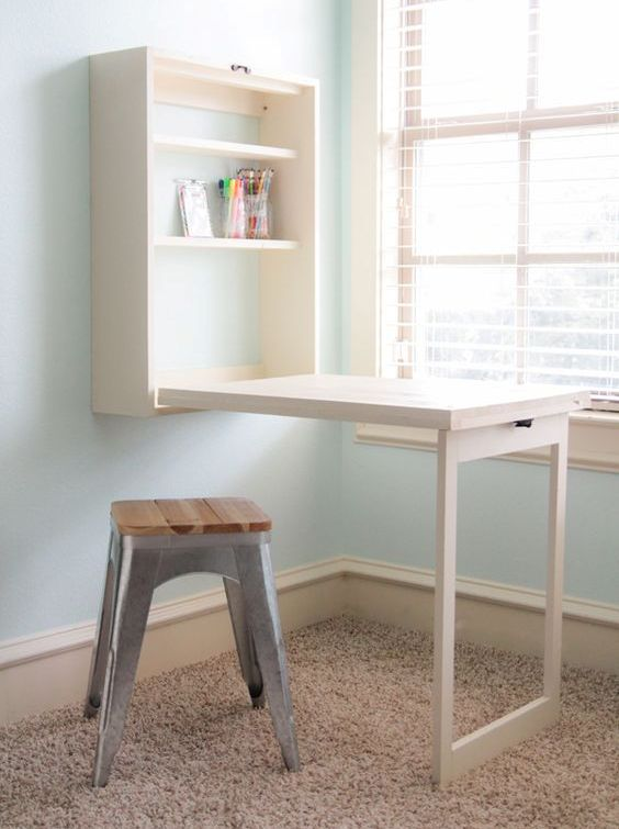 a white Murphy desk with storage shelves is great for crafters that don't have a separate room