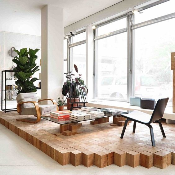 a wooden cube platform by the window is a gorgeous way to highlight the reading space