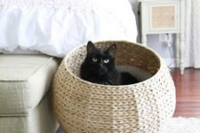 a woven raised cat bed styled as a pod is a stylish idea for a modern farmhouse home