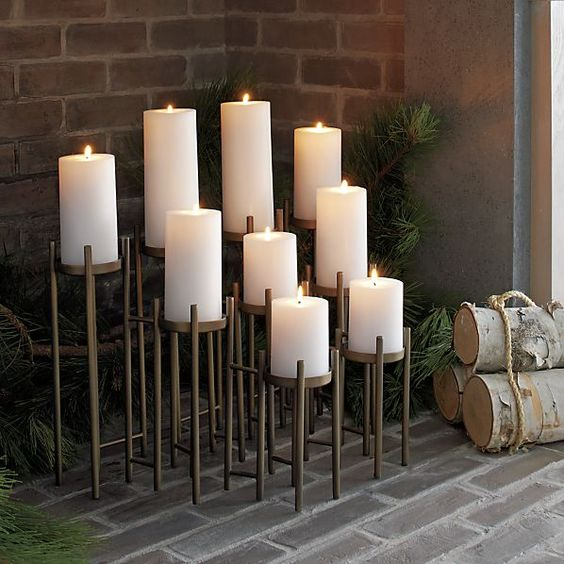 an architectural candelabra for nine pillar candles on graduated risers on long lean legs