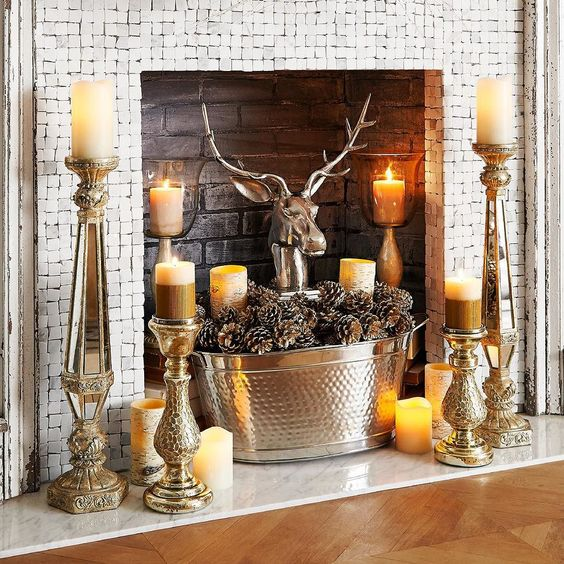 bold rustic styling with candles placed on vintage candle holders, a tub with pinecones and a fake deer head