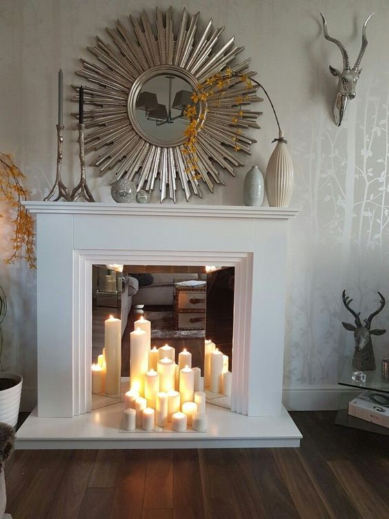 if you place some mirrors in the fireplace, the light will be reflected
