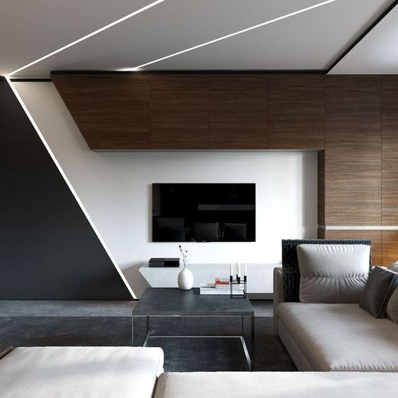 a bold minimalist living room with dark stained wood, geometric touches, a sectional sofa and built-in lights for a futuristic feel