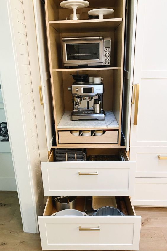 a cabinet with appliances and drawers and various tableware is a stylish solution for any kitchen