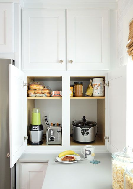 a cabinet with appliances and various stuff for making sandwiches is a cool idea for making breakfasts here