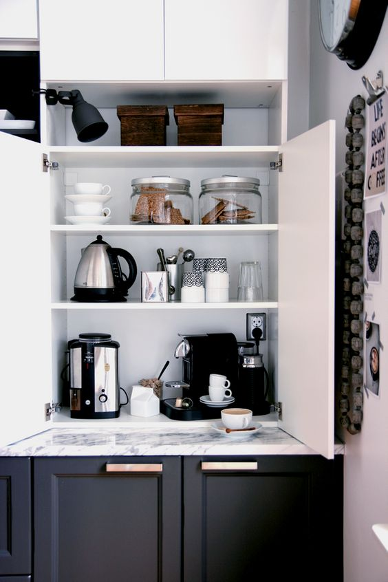 a cabinet with appliances, jars and mugs hidden inside and various stuff turn it into a pretty coffee station is a cool idea