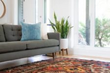 a colorful boho rug isn't only a hot decor trend but also a way to sound proof your home