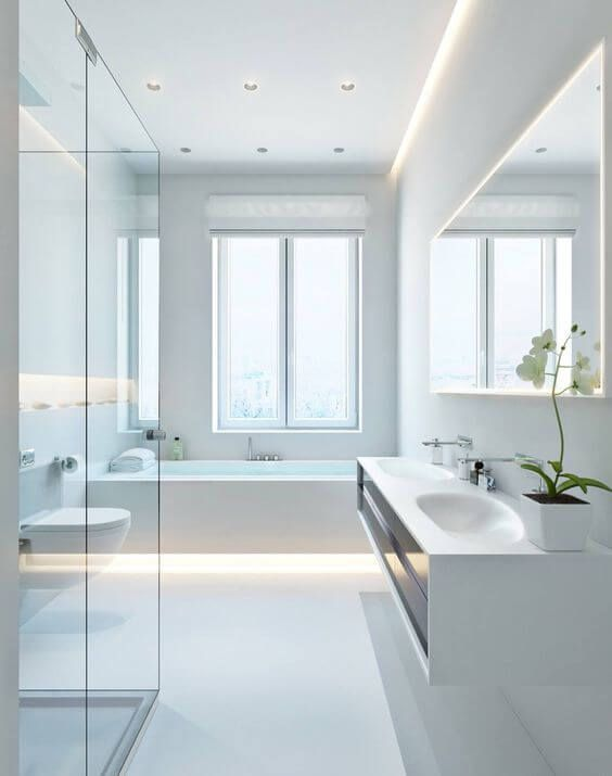 a pure white minimalist bathroom with a floating vanity, a bathtub with built-in lights, a shower clad with glass and a window