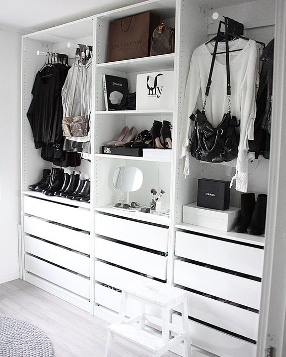 a simple and minimalist closet with holders for clothes and bags, with drawers and open shelves for various stuff