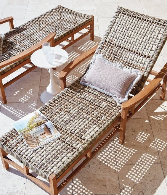 a stained wooden lounger with wicker and a cool pillow is a great idea for a touch of nature or a slight rustic feel