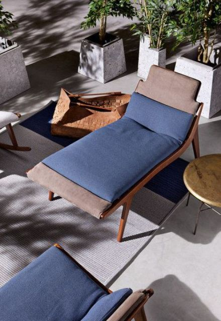 a stylish and sleek stained wooden lounger with taupe and blue upholstery is a nice idea for a modern or contemporary space