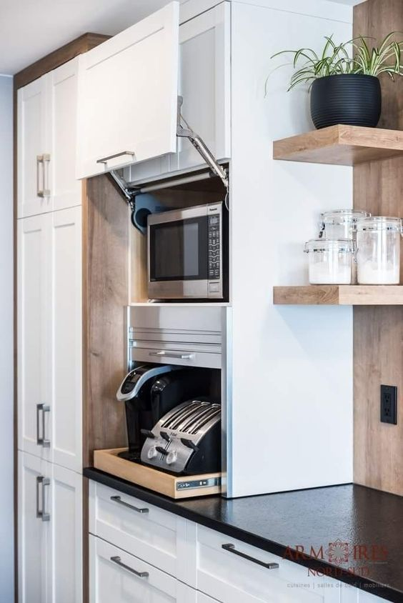 a stylish cabinet with sliding doors is a cool holder for various appliances and you may use them right here without taking them out