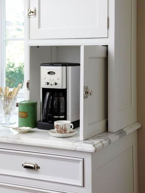 a tiny cabinet with a coffee machine, mugs and sugar is a real mini coffee station that will fit any kitchen