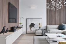 an elegant minimalist living room with wood panels, a floating TV unit, laconic neutrla furniture and artworks