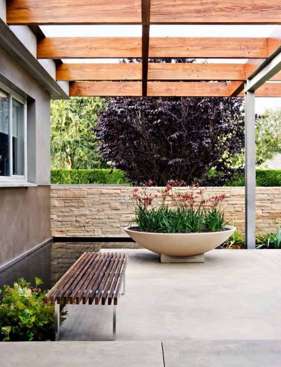 an oversized white concrete bowl planter is a stunning modern planter piece you can rock in your outdoor space
