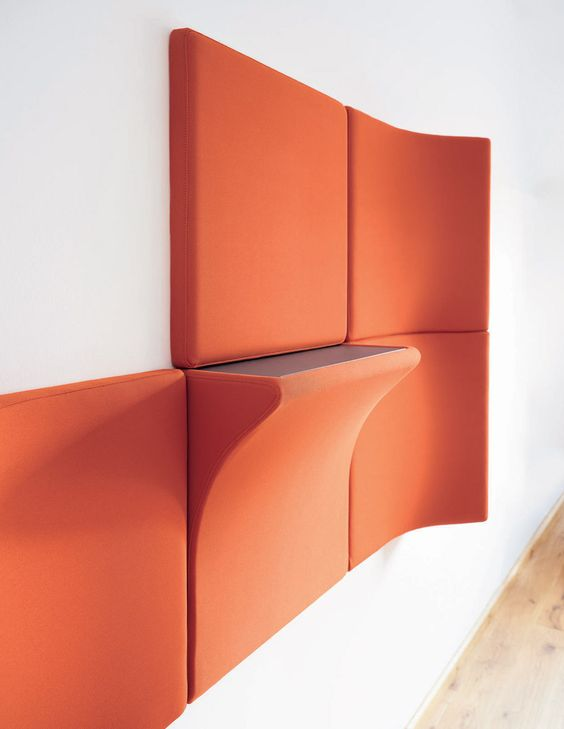 bold orange acousitc panels and a panel with an additional shelf is a very functional idea