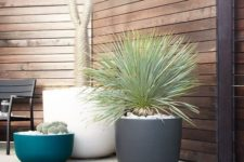 bowl-like white, grey and blue planters of different heights will make your outdoor space cooler