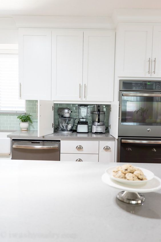 built-in doors make this part of countertop a little cabinet for hiding appliances inside and decluttering the kitchen