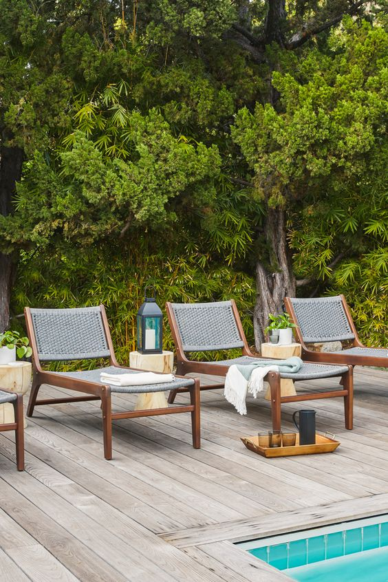 chic modern loungers of stained wood and grey wicker are amazing for a modern outdoor space, add blankets and pillows
