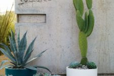 cup-like planters of various colors and sizes compose a chic modern arrangement that you can rock