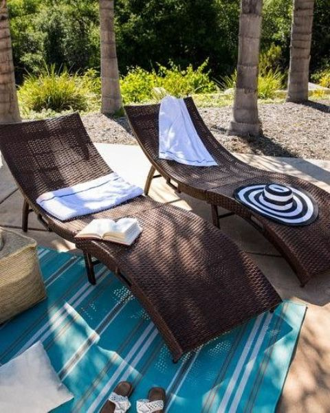 gorgeous dark curved wicker loungers with blankets and pillows are perfect for tropical, rustic and modern spaces