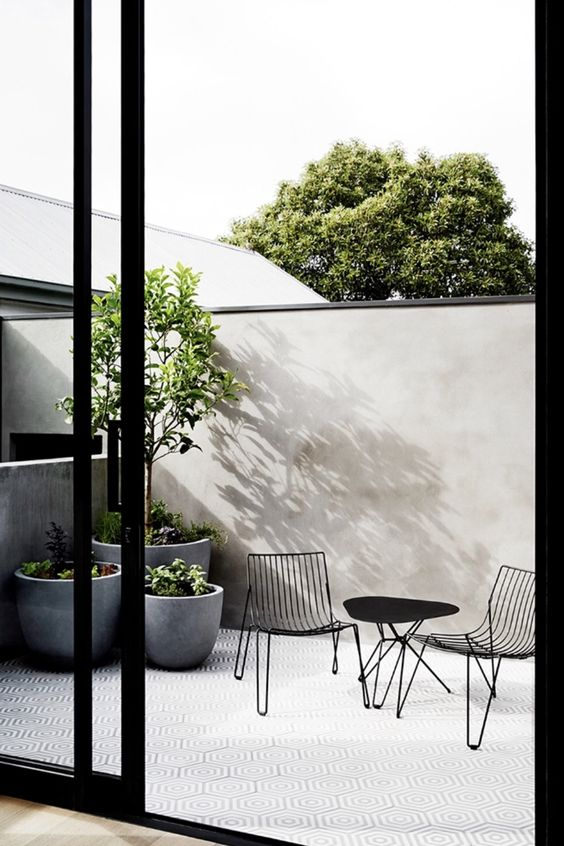 grey concrete cup-like planters are very chic and very modern, they will fit many outdoor spaces